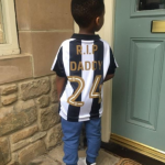 Cheick Tioté's son Rafael wearing Newcastle shirt with 'RIP Daddy' printed on the back