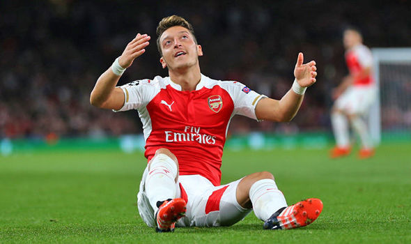 Mesut Özil kicks door after Arsenal's defeat by Tottenham Leaving Stud marks