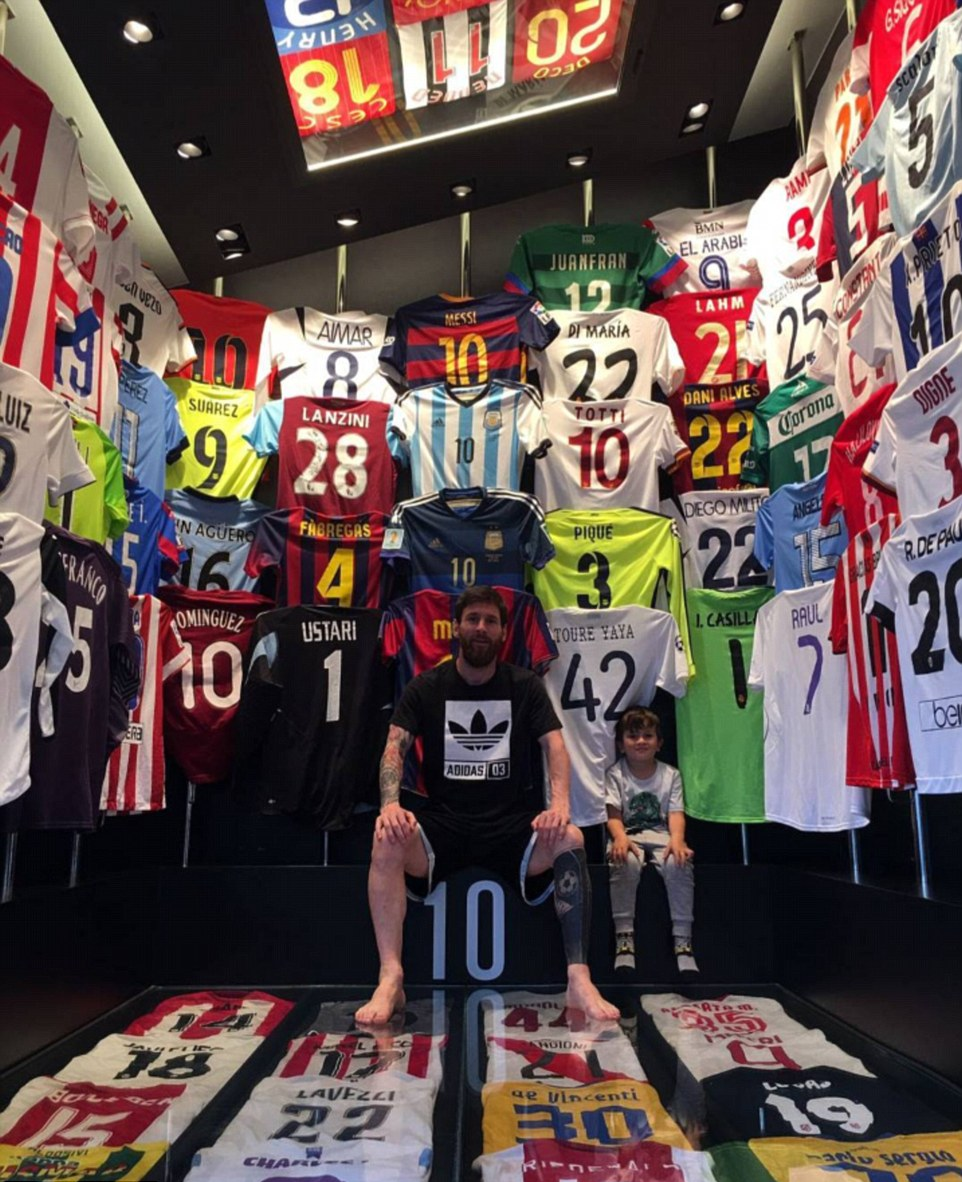 Messi shows off his collection of Shirts of star players he has been on a pitch with.