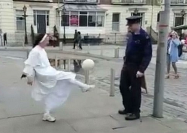 Hit or Hit! nun playing keepy uppys with a policeman in the street