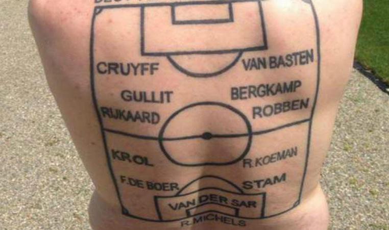 Oranje fan reveals bizarre all-star XI back tattoo