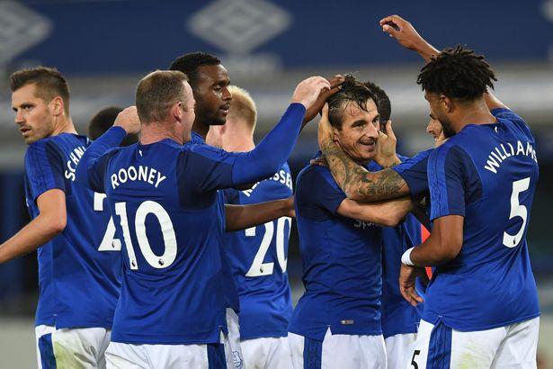 Everton players celebrating their first Leg goal