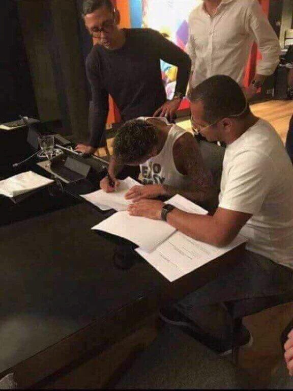 Neymar jr signing the dotted lines for more