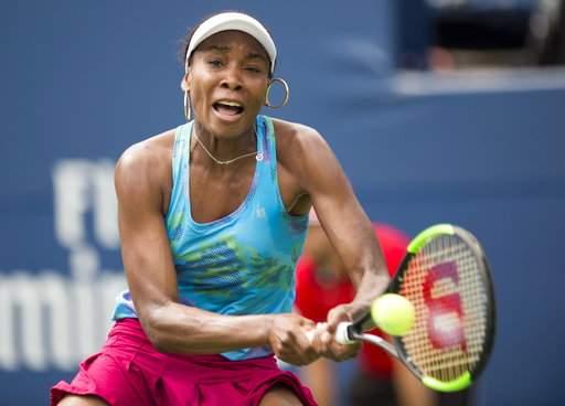 Venus Williams battles into Toronto last 16, Garbine Muguruza through