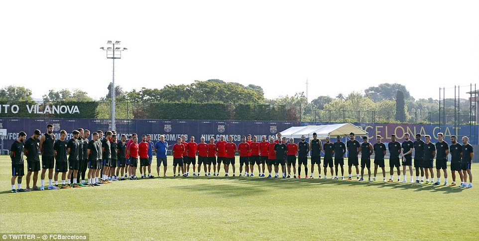 Barcelona players and coaching staff pay tribute to terror attack victims with a minute's silence in training
