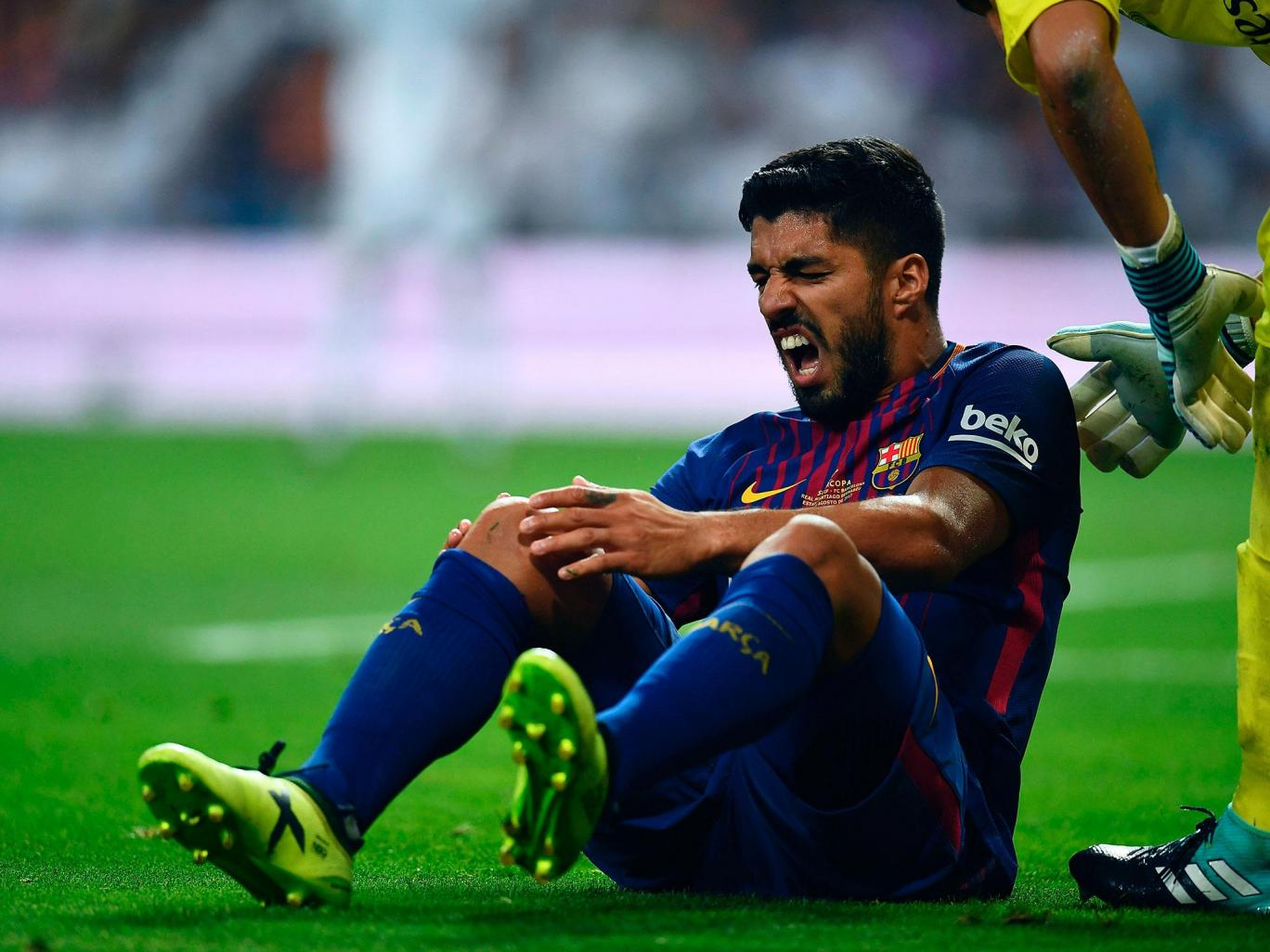 Barcelona suffer fresh blow after Luis Suarez ruled out for one month with knee injury