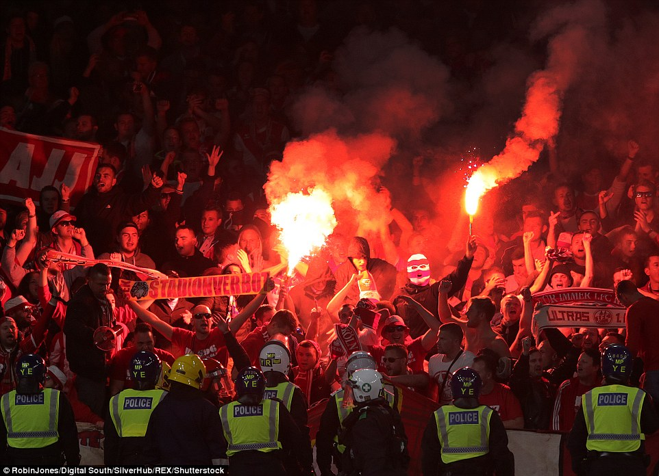 Arsenal could face sanctions and be fined up to £25,000 as Uefa investigate Cologne fan fiasco