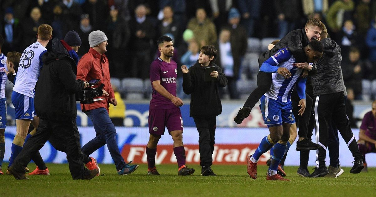 Violent reactions as Wigan dump 10-man Man City out of FA Cup