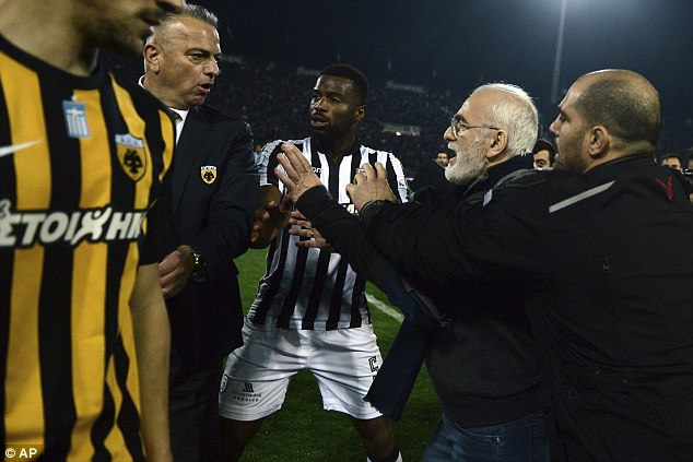 Unbelievable! Greek Club, PAOK Chairman invades pitch with Gun to attack Referee