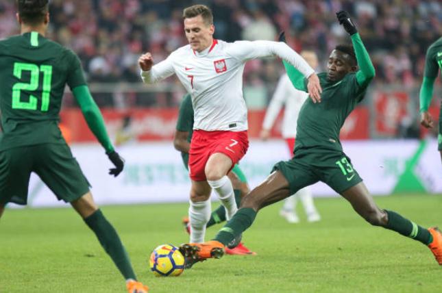 "Former Super Eagles Striker Hails team's ""Fighting Spirit"" against Poland"