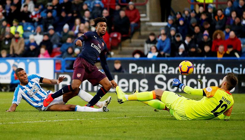 Iwobi goal earns Arsenal rare away win over Huddersfield