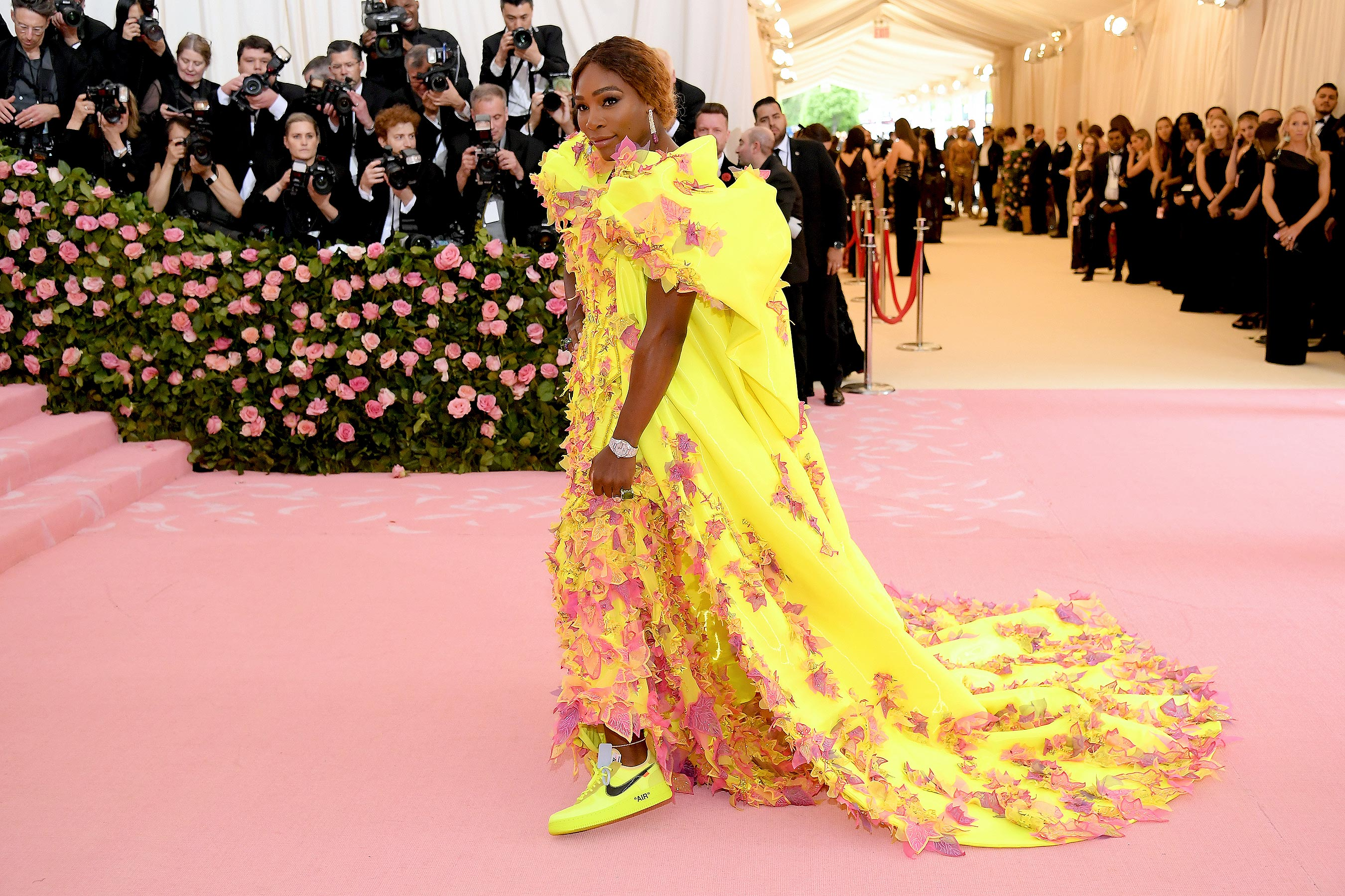 Serena Williams Pairs Designer Sneakers with High-Fashion Gown on pink carpet