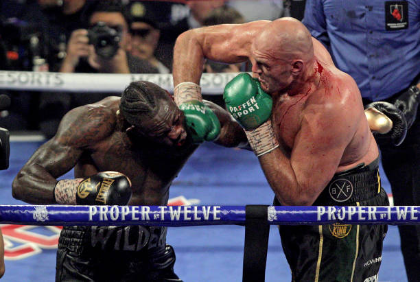 Battered Wilder slams his corner for throwing in the towel